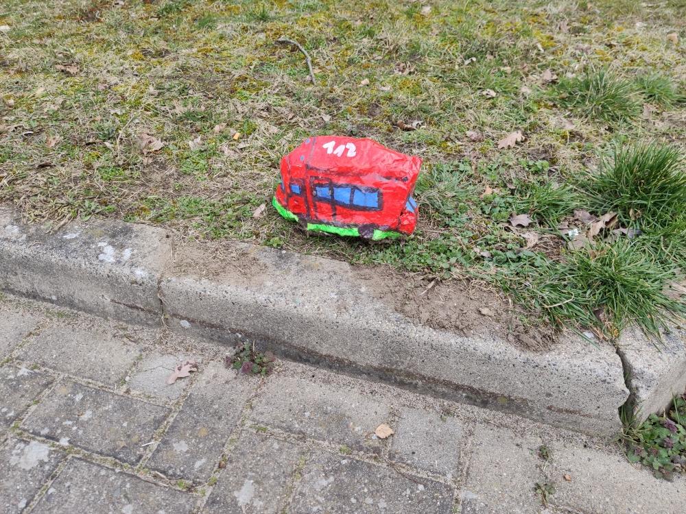 Feuerwehrfahrzeug als Stein